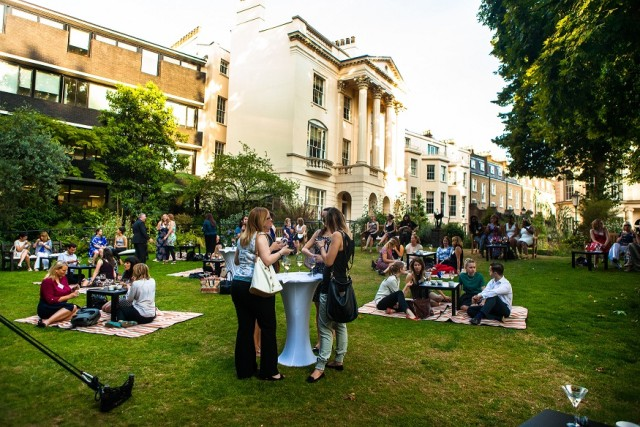 Garden Party with guests enjoying a standing drinks reception with view of the heritage buildings in the background Royal College of Physicians Venue Hire NW1