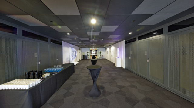 Futurecities Technology Tunnel set out for a drinks reception with poseur tables centred in the room and draped with black smart linen Level 39 Christmas Party E14