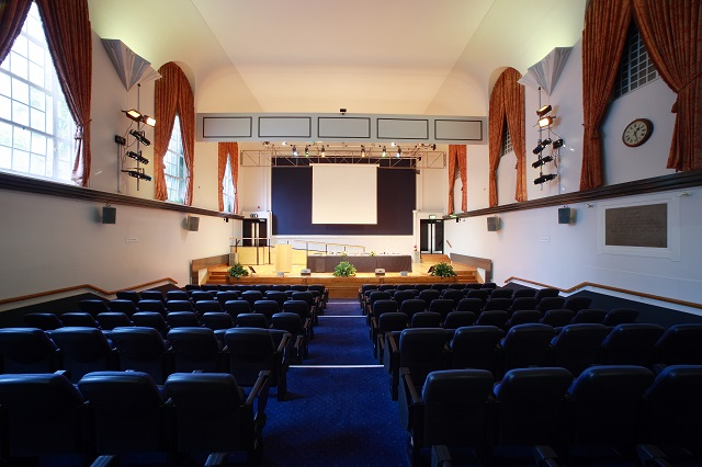 Tuke Hall set in theatre style for a conference with presentation facilities and a stage Regent's Conferences and Events Venue Hire NW1
