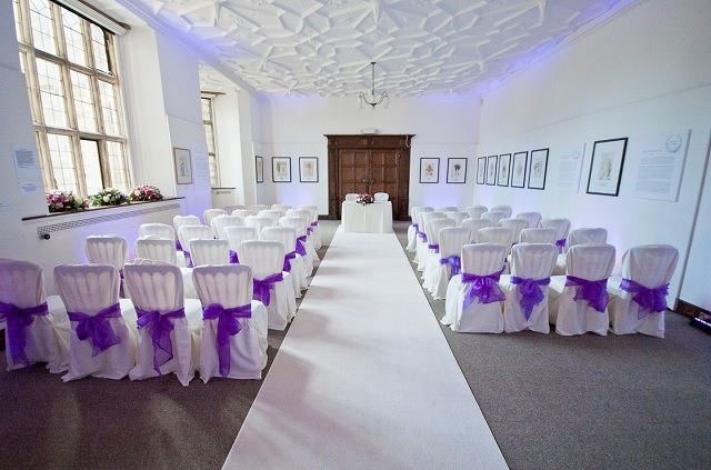 Gallery set for a wedding ceremony with chair covers with bows Wakehurst Place Venue Hire RH17