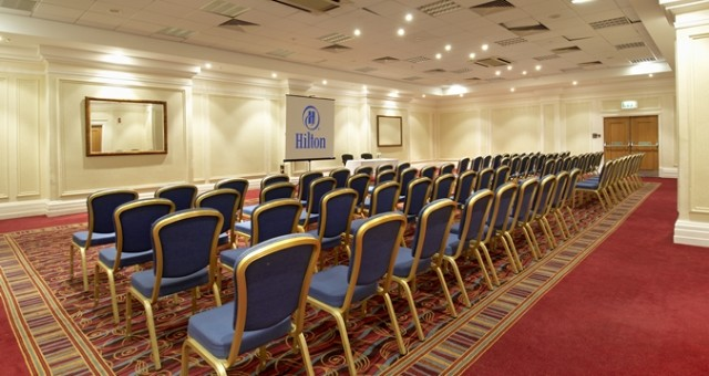 Wembley Suite set out for a meeting with chairs facing a large projector screen and set in theatre styleHilton Nottingham Venue Hire NG1