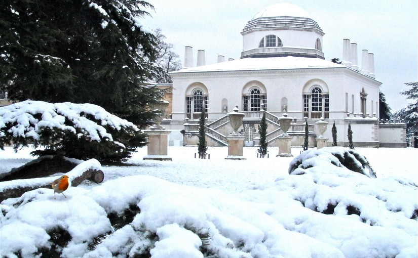 Exterior view of the venue covered with snow and a red robin bird in the corner Chiswick House Christmas Party W4