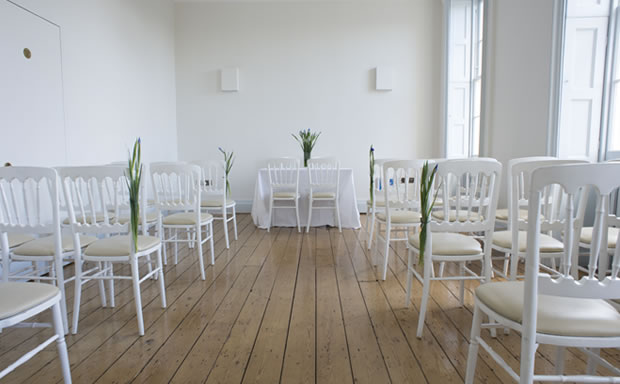 New River Room set for an intimate wedding ceremony with classic wooden paneled flooring Clissold House Venue Hire N16