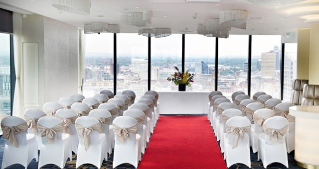 Ceremony set up for a wedding with floor to ceiling views over Manchester which chairs set in theatre stlye facing the front of the room Cloud 23 Venue Hire M3