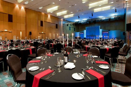 Deansgate Suite set up for a gala dinner with round tables dressed with table linen and candelabras Hilton Manchester Deansgate Venue Hire M3