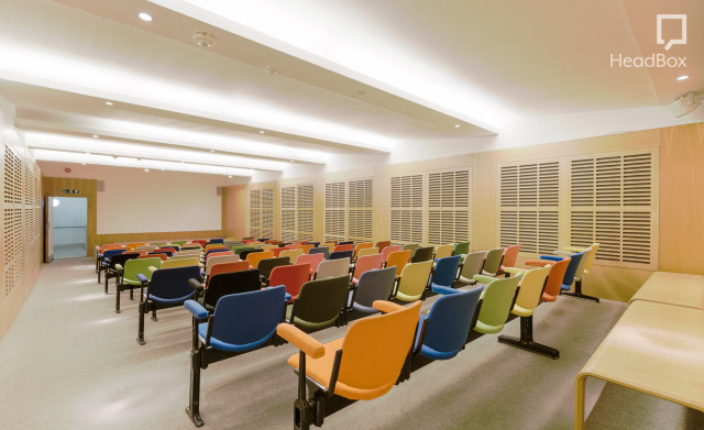 Zilkha Auditorium set in theatre style for a meeting with multicoloured chairs and presentation facilities at the front Whitechapel Gallery Venue Hire E1