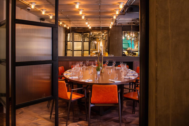 Private Dining set for a Christmas meal with private glass door entrance and oval table set for 14 guests Drake & Morgan Kings Cross Christmas Party N1
