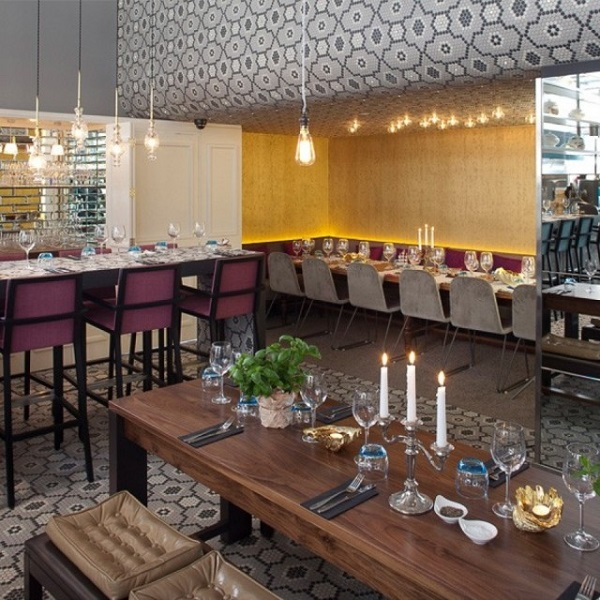 Drift Bar Venue Hire EC2. Drifts space space with different chairs and table furnishings with plants and candles as centre pieces.