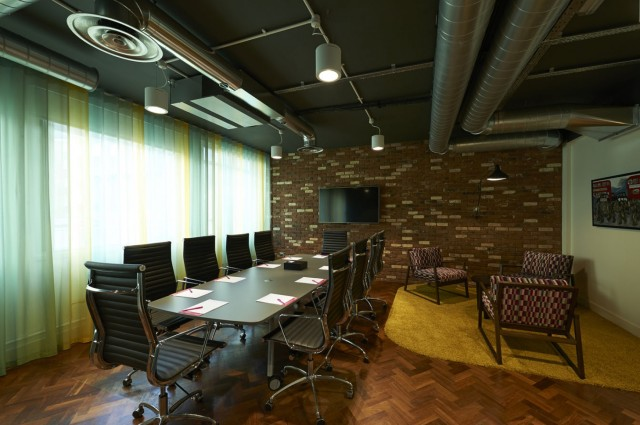 Stylistic Meeting Room with exposed brick work and informal seating as well as a boardroom layout with natural daylight Marble Arch Venue Hire W1