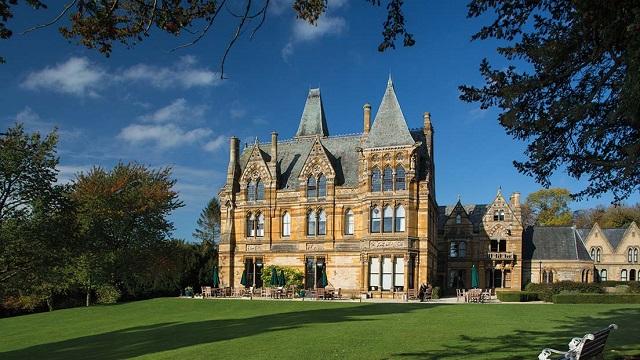 Ettington Park Hotel Venue Hire CV37. exterior of historic venue with it gorgeous land surrounding building