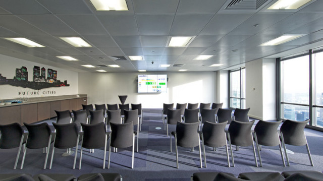 Futureminster Sandbox Space set for a conference in theatre style with presentation screen at the front and lots of natural daylight Level 39 Venue Hire E14