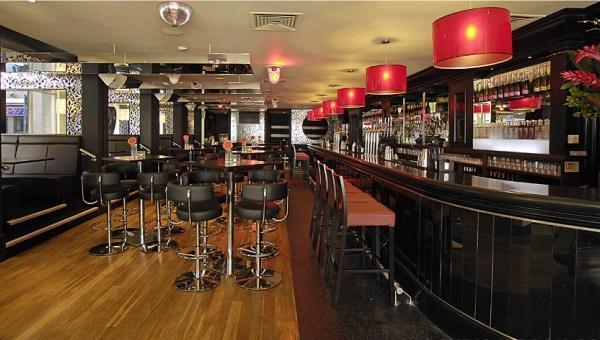 Gem Bar London Christmas Party W1, bar with black furniture