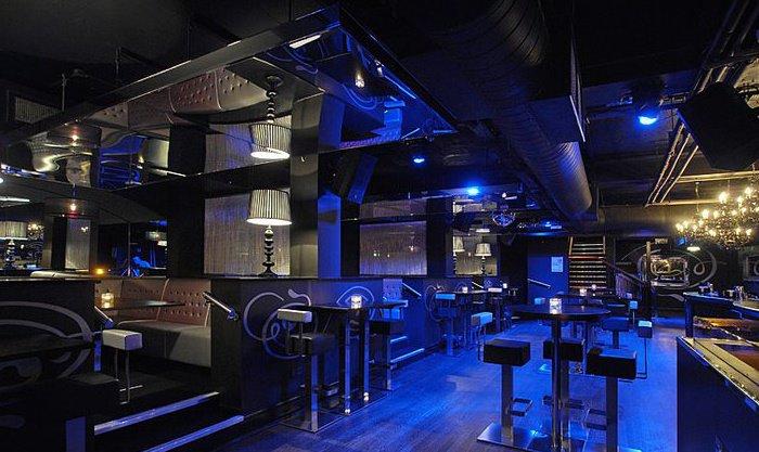 Gem Bar London Christmas Party W1, blue lighting on silver funriture