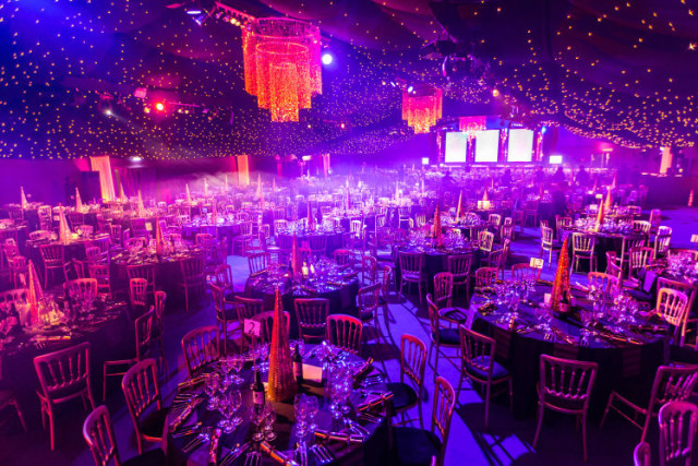 Boogie Wonder Shared Christmas Party EC2, seated dinner set up, large event space, 900 seated capacity, lighting and festive novelties