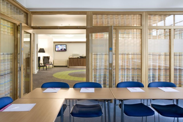 Meeting Room with glass wall partition and large open plan room behind. Room set in u-shape for a board meeting The Hatton Venue Hire EC1