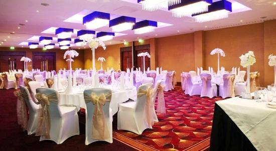 Kensington Close Hotel Venue Hire, seated dinner, round tables, centre pieces
