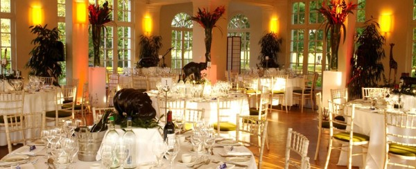 Mappin Pavilion set for a dinner with round tables, impressive centre pieces and white linen ZSL London Zoo Venue Hire NW1