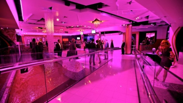 Madame Tussauds drinks reception with bright pink uplighers Venue Hire NW1