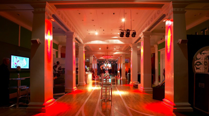 Madame Tussauds view of the venue with orange uplighters for a drinks reception Venue Hire NW1