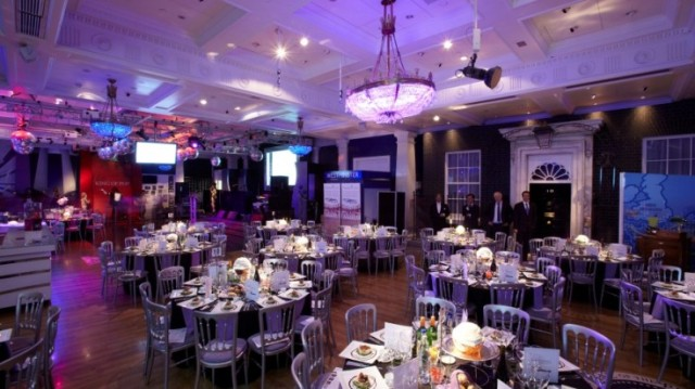 Madame Tussauds set for a large dinner with round tables dressed in purple linen Venue Hire NW1