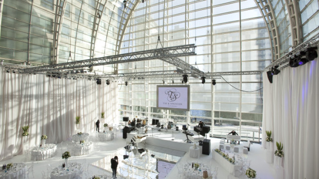 Main Hall set for a wedding with glass wall and lots of natural light and presentation facilities with light rigging East Wintergarden Venue Hire E14