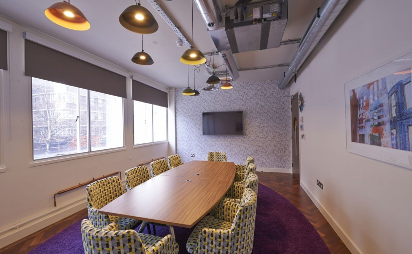 Meeting Room with natural daylight quirky lampshades and boardroom style layout with pattern lounge chairs Marble Arch Venue Hire W1