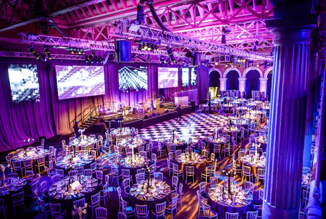 Old Billingsgate Shared Christmas Party EC1, seated dinner set up, round tables, dancefloor in the centre