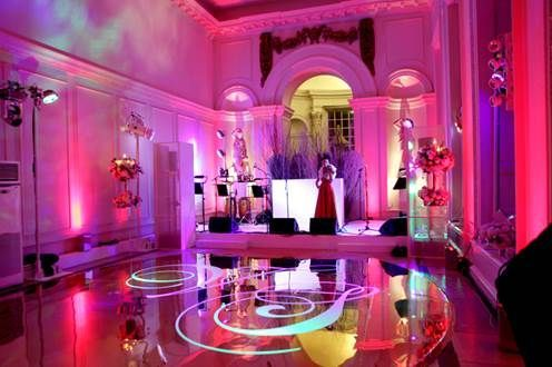 Orangery with stage set for the band entertaining guests at a Christmas party Kensington Palace Christmas Party W8