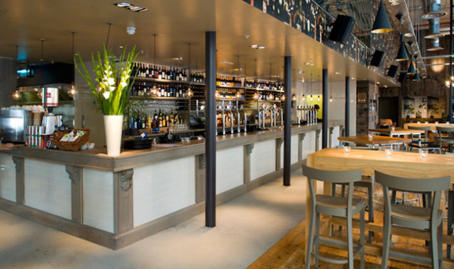 View of the corner of the bar with view of the restaurant in the background and high stool seating in front Refinery Bankside Venue Hire SE1