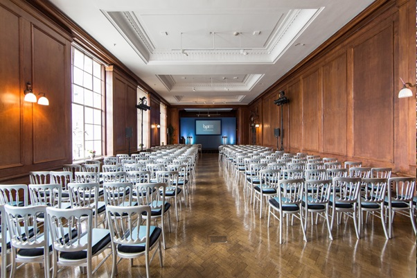 River Rooms set for a conference with chairs set in theatre style and large presentation screen with natural daylight Venue Hire SE1