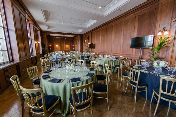 River Rooms with round tables set for a formal dinner with table linen and natural daylight in the room Venue Hire SE1
