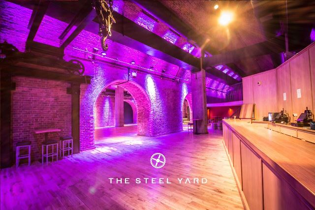 Steel Yard London Venue Hire EC3, purple uplighters on the brick work