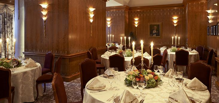 Savoy Hotel Christmas Party WC2, indoor wooden ceilings with red seats