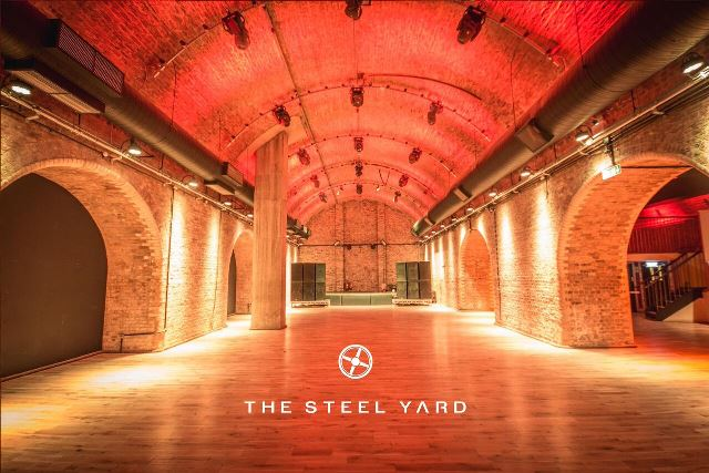 Steel Yard London Venue Hire EC3, brick work with up lighters and arched roof