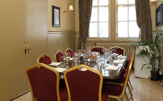 The Study set for a boardroom meeting with notepads set for the meeting Rooms at Browns Covent Garden Venue Hire WC2