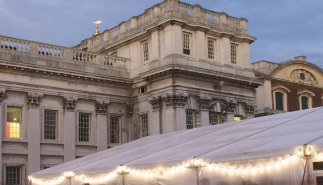 King Charles Lawn with marquee in from of the heritage venue with fairy lights around it for a summer party Old Royal Naval College Venue Hire SE10