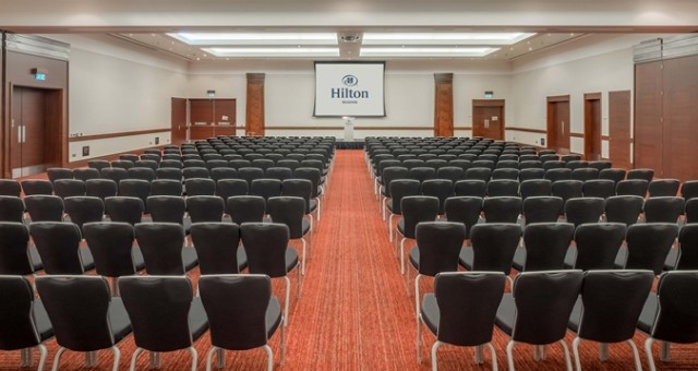 Ballroom set up for a meeting in theatre style with large screen at the front of the room Hilton Reading Venue Hire RG2