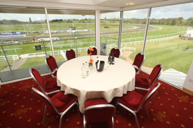 Directors Box set for a dinner with private view of the raceourse with round table dressed in white table linen Lingfield Park Hotel & Country Club Summer Party RH7