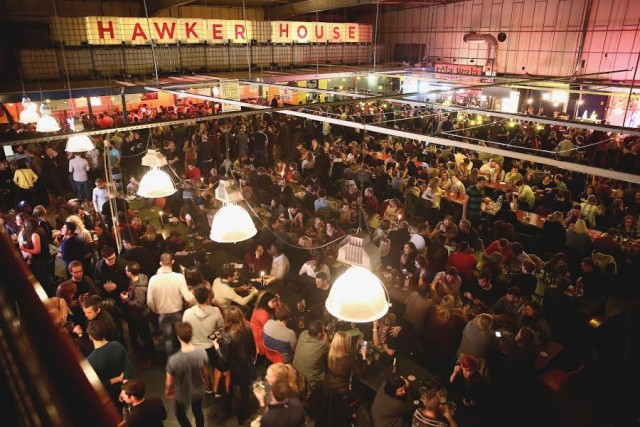 Big Room Hawker House filled with thousands of guests enjoying informal street food Christmas Party SE16