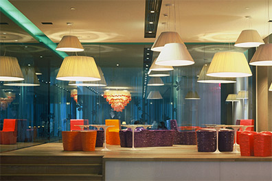 Lobby with brightly coloured seating and arty lamps hanging from the ceiling Nhow Milan Venue Hire Italy