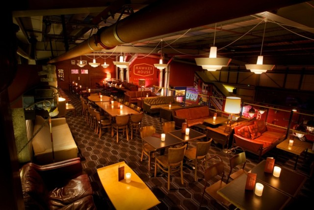 view of the Mercury Lounge with quirky carpet and furniture and candles Hawker House Christmas Party SE16