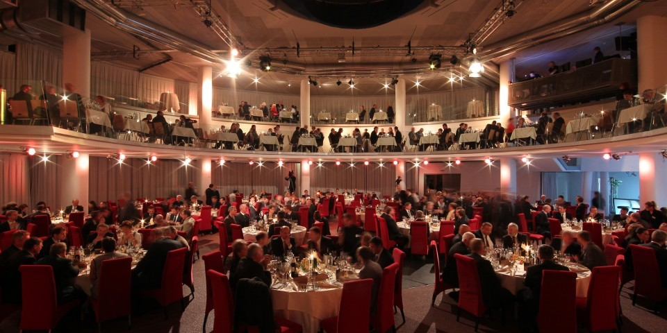 two floors open plan filled with round dinning tables all light in red and white