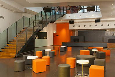 T35 by Nhow with lots of colourful informal seating and a glass framed staircase Nhow Milan Venue Hire Italy