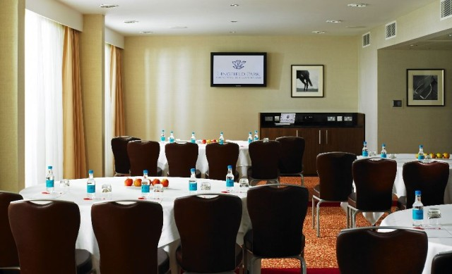 Chartwell Suite Suite set fir a meeting with round tables set in cabaret style dressed with white linen and chairs facing the front of the room Lingfield Park Hotel & Country Club Venue Hire RH7