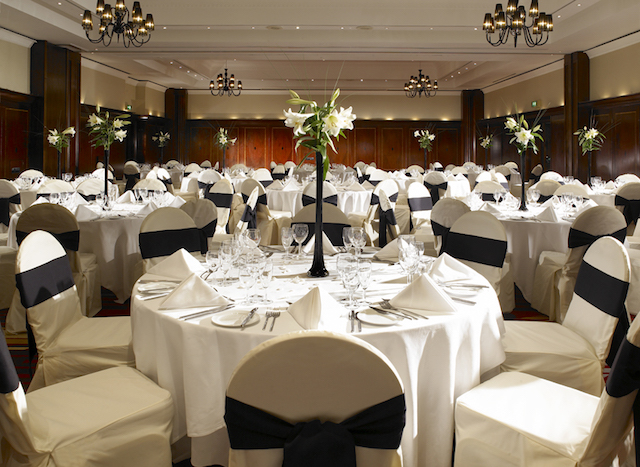 Leeds Marriott Christmas Party SL1. venue decorated with large round tables with festive centre pieces.