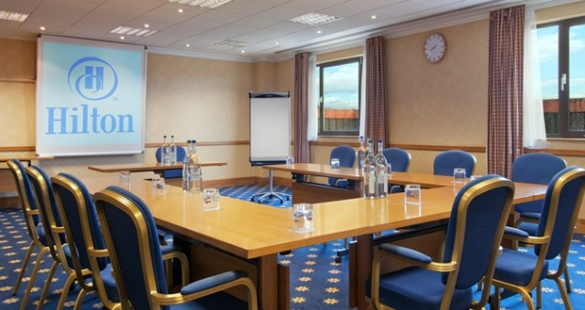 Training Room with table set up in u-shape style with flipchart and window in the corner Hilton Swindon Venue Hire SN5