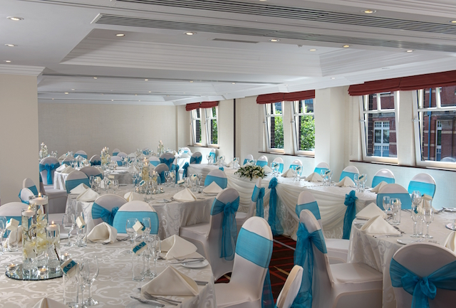 Leeds Marriott Christmas Party SL1. large spacious hall room with tables and chairs set out for christmas party.