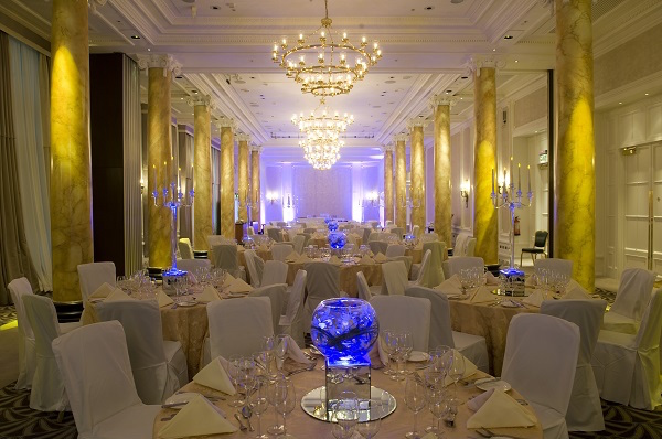 Waldorf Hilton Venue Hire WC2, seated dinner, stunning centre pieces and chair covers