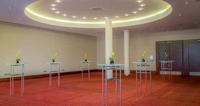Windsor Foyer set our for a drinks reception with glass poseur tables dotted around the room Hilton Reading Venue Hire RG2