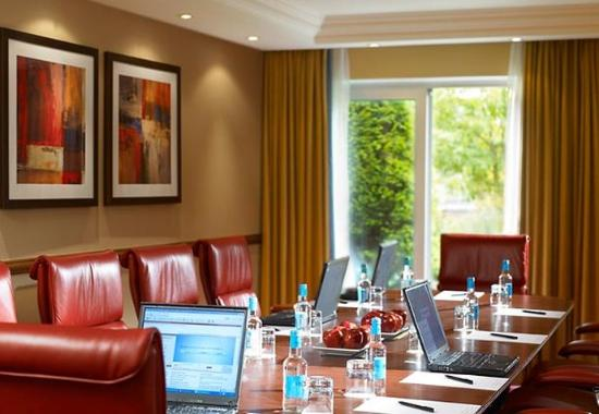 Boardroom set for a meeting with formal leather high back chairs and floor to ceiling window with lots of natural daylight Marriott Heathrow Windsor Hotel Venue Hire SL3